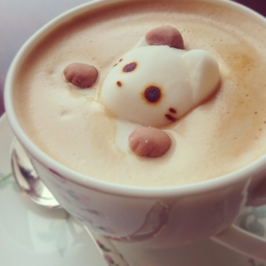 latte with a cat figure inside it at a cafe.